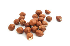 Heap of tasty hazelnuts on white. Background closeup stock images
