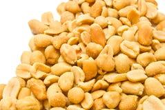 Heap of tasty peanuts closeup. Heap of roasted peanuts on white background stock photo