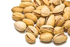 Heap of tasty pistachios on white Royalty Free Stock Image