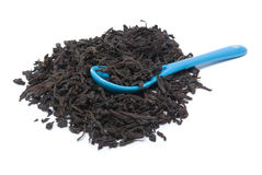 Heap of tea and teaspoon Royalty Free Stock Image