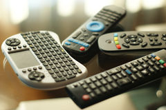 Heap of television remote controllers. Of various colors and technologies Stock Image