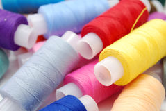 Heap of Threads. Heap of Colored Sewing Thread Spools Closeup Stock Images