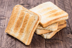 Heap of toast on wood Royalty Free Stock Photo