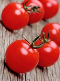 Heap of tomato cherry on rustic table Stock Image