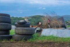 Heap of Trash on Organic Farm. Junk Pile building up on organic farm in Vermont, USA Royalty Free Stock Photography
