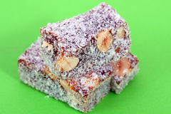 Heap of turkish delight on green Stock Images