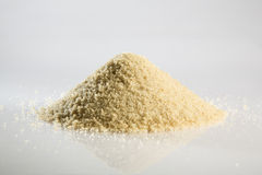 Heap of uncooked fonio. Heap of fonio on white background background stock images