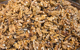 Heap of unshelled walnuts. Background Stock Photos