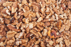 Heap of unshelled walnuts Stock Photography