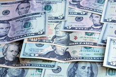 Heap of US dollars, notes of different values. Money background Stock Images