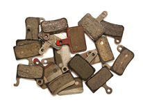 Brake pads. A heap of used bicycle brake pads  on white Stock Images