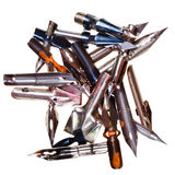 Heap of used metal nibs. Isolated on white background Royalty Free Stock Image