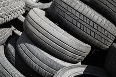 Heap of used worn-out automotive tires Royalty Free Stock Photo