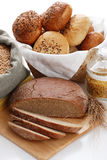 Heap of various bread, bag with wheat and macaroni Royalty Free Stock Images