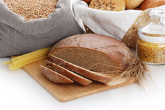 Heap of various bread, bag with wheat and macaroni Stock Photo