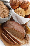 Heap of various bread, bag with wheat and macaroni Stock Photography