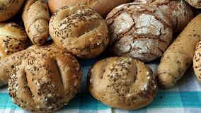 Heap of various bread rolls sprinkled. With salt and caraway, sesame. Fresh rustic bread from leavened dough stock footage