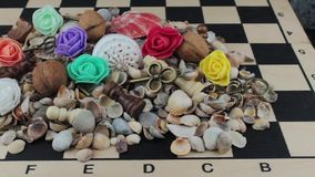 Heap of objects on a chessboard stock video footage