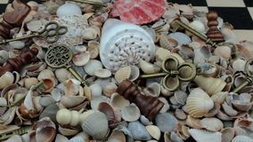 Heap of shells, chess and keys stock video footage