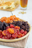 Heap of Various Dried Fruits in Wooden Plate Stock Photos