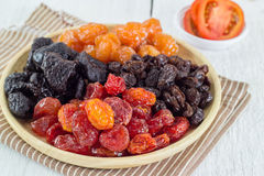 Heap of Various Dried Fruits in Wooden Plate Royalty Free Stock Photos