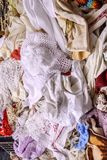 Heap of vintage cloths on sale at street market, Chiavari, Italy Royalty Free Stock Image