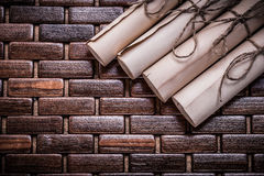 Heap of vintage parchment rolls on wicker wooden Royalty Free Stock Images