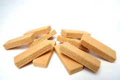 Heap of wafers with a vanilla cream. On a white table Royalty Free Stock Photo