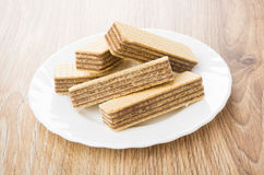 Heap of wafers in white plate on table Stock Photo