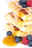 Heap of waffles with fruits Royalty Free Stock Images