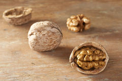 Heap of walnuts. Cracked walnut on table top Stock Image