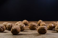 Heap of walnuts. On wooden table Royalty Free Stock Images