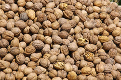 Heap of walnuts on a market stall Royalty Free Stock Photography
