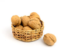 Heap of walnuts,. Heap of walnuts in the small basket Royalty Free Stock Images