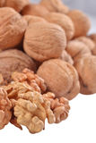 Heap of walnuts on a white Stock Photos