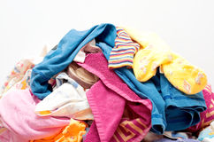 Heap Wash clothes close-up. Heap Wash clothes, towels, t-shirts, children's clothes Royalty Free Stock Images