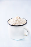 Heap of wheat flour in white vintage cup Royalty Free Stock Image