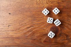 Heap of white dice on rustic wooden table top view. Gambling devices. Game of chance concept. royalty free stock photo