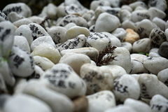 Heap of white pebble stones with religious wishes in the Japanese temples (Shinto shrines) Stock Photography