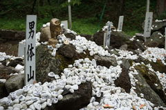 Heap of white pebble stones with religious wishes in the Japanese temples (Shinto shrines) Royalty Free Stock Image