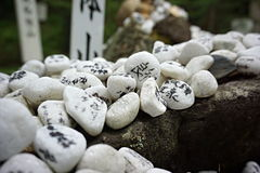 Heap of white pebble stones with religious wishes in the Japanese temples (Shinto shrines) Stock Images