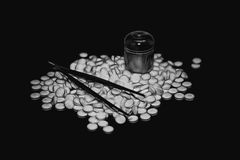 Heap of white pills. Pile of round tablets on a black background. Illustration Royalty Free Stock Photos