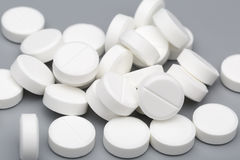 Heap of white round tablets medical Stock Photo