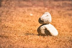Heap of white stone stack of rock decoration in vertical style composition, copy space. Harmony, stability, strength, well being, stock photos