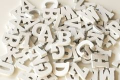 Flat lay wooden letters, close up, white background royalty free stock photography