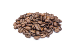 Heap of whole coffee beans on white Royalty Free Stock Photography