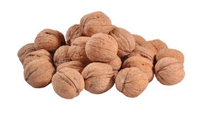 Heap of whole walnuts on a white Stock Images