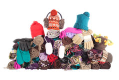 Heap of winter accessories | Isolated. Huge pile of woolen winter scarfs, hats and gloves. Isolated over white Royalty Free Stock Photos