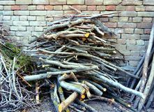 Heap of firewood against brick wall stock images