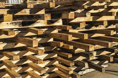 Heap of wooden pallet. Wooden pallet overlap in warehouse Royalty Free Stock Image